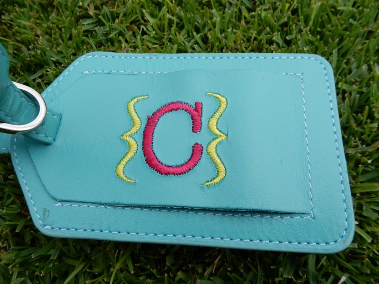 Leather bag tag, Anita Goodesign embroidery design.